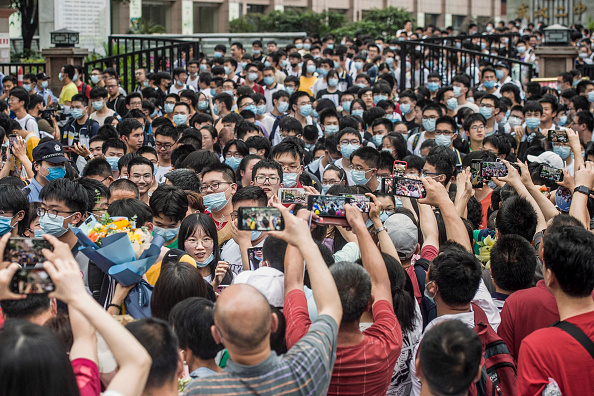 Students leaving a school after finishing the National College Entrance Examination (NCEE), known as Gaokao, in Wuhan,  China, on June 9, 2021. (STR/AFP via Getty Images)