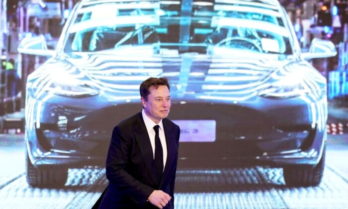 Tesla Inc CEO Elon Musk walks next to a screen showing an image of Tesla Model 3 car during an opening ceremony for Tesla China-made Model Y program in Shanghai, China, on Jan. 7, 2020. (Aly Song/File Photo/Reuters)