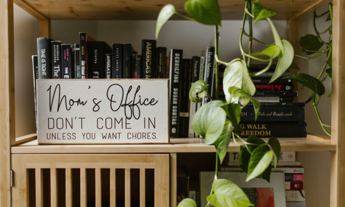 Office sign on a bookshelf. (Pexels)