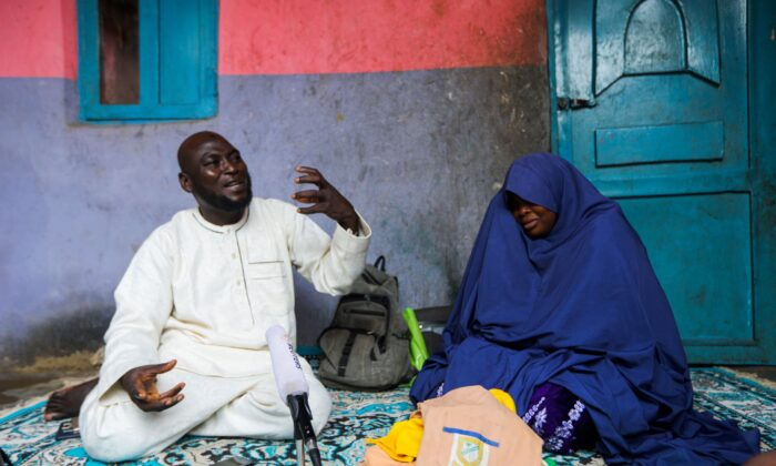 Abubakar Adam and his wife, parents of seven children kidnapped at Salihu Tanko Islamic school by bandits, speak during an interview with Reuters at their house in Tegina, Niger State, Nigeria, on Aug. 11, 2021. (Afolabi Sotunde/Reuters)