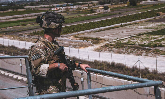 A soldier assigned to the 82nd Airborne Division provides security at Hamid Karzai International Airport, Afghanistan, on Aug. 21, 2021. (U.S. Marine Corps/Cpl. Davis Harris)