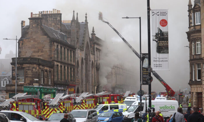 Firefighters at the scene of a large fire at George IV Bridge in Edinburgh, UK, on Aug. 24, 2021. Picture taken with permission from the twitter feed of Matt Donlan. (Matt Donlan/Twitter/PA)