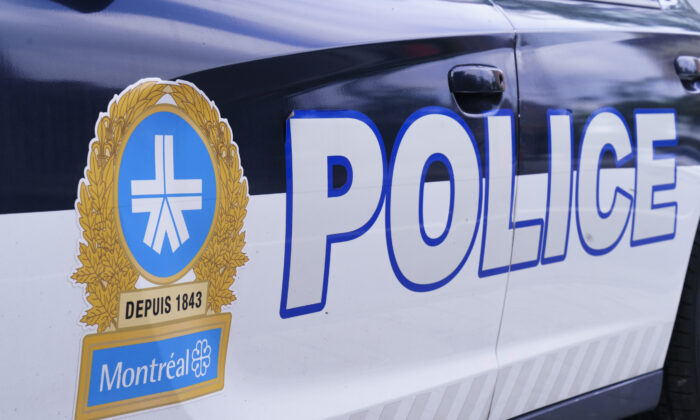 The Montreal Police logo is seen on a police car in Montreal on July 8, 2020. (The Canadian Press/Paul Chiasson)