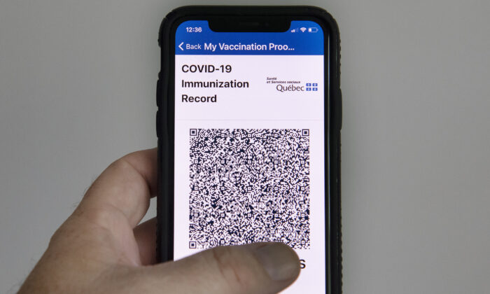 The Quebec government's new vaccine passport called VaxiCode is shown on a phone in Montreal on Aug. 25, 2021. (The Canadian Press/Graham Hughes)