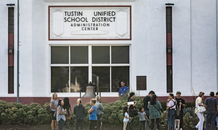 Parents and students gather to voice concerns on education practices to the Tustin Unified School District Board of Education in Tustin, Calif., on Aug. 23, 2021. (John Fredricks/The Epoch Times)
