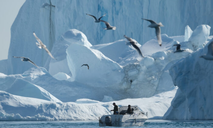 A man fishes near icebergs in the Ilulissat Icefjord in western Greenland on Aug. 4, 2019. (Sean Gallup/Getty Images)