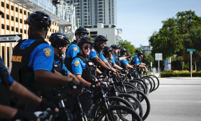A row of police cyclists is seen during a rally in Fort Lauderdale, Florida on May 31, 2020. (Eva Marie Uzcategui/AFP via Getty Images)