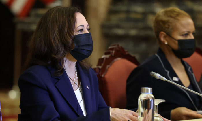 U.S. Vice President Kamala Harris meets Vietnam's President Nguyen Xuan Phuc during a bilateral meeting at the Mirror Room of the Presidential Palace, in Hanoi, Vietnam, on Aug. 25, 2021. (Evelyn Hockstein/POOL/AFP via Getty Images)