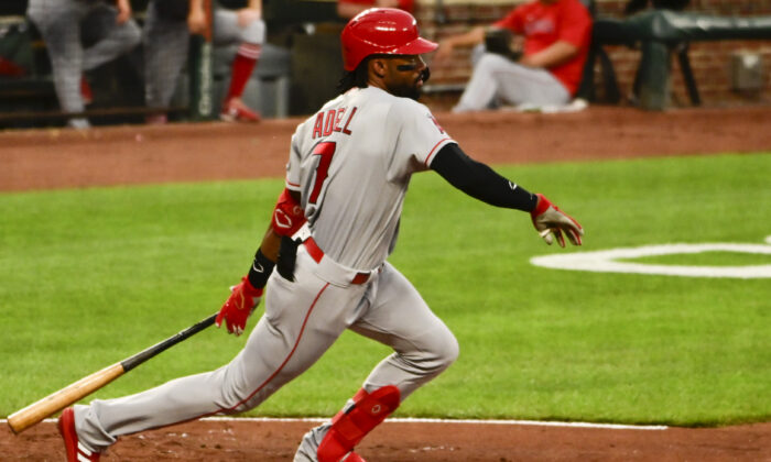 Los Angeles Angels center fielder Jo Adell (7) hits as rbi triple during the second inning  against the Baltimore Orioles at Oriole Park at Camden Yards in Baltimore, Md., on Aug 24, 2021, (Tommy Gilligan/USA TODAY Sports via Reuters)
