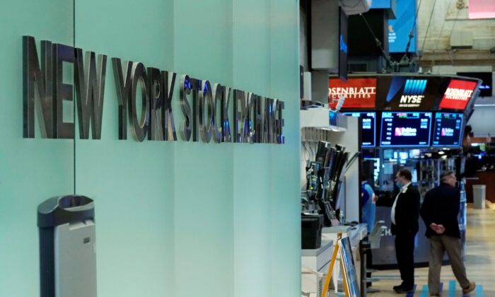 Traders work on the floor of the New York Stock Exchange, on July 19, 2021. (Richard Drew/AP Photo)