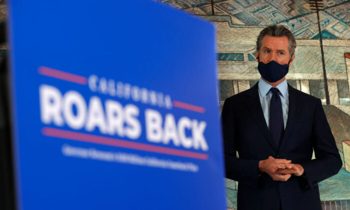 California Gov. Gavin Newsom looks on during a press conference in Oakland, Calif., on May 10, 2021. (Justin Sullivan/Getty Images)