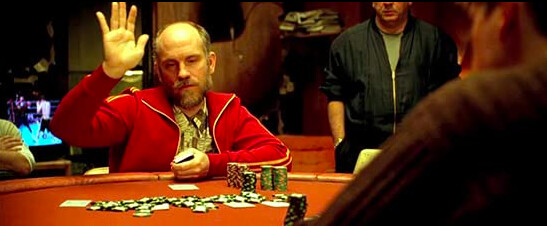man in red jacket throwing poker chips in ROUNDERS