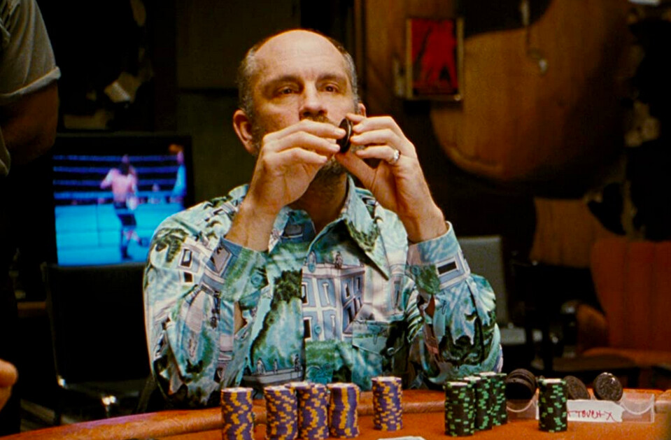 man with oreo cookie and poker chips in ROUNDERS