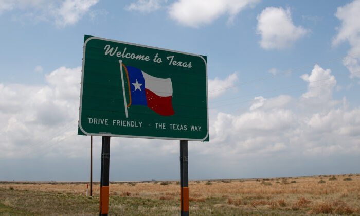 A 'Welcome to Texas' sign stands on the side of the road near Dalhart, Texas, on May 9, 2017. (Drew Angerer/Getty Images)