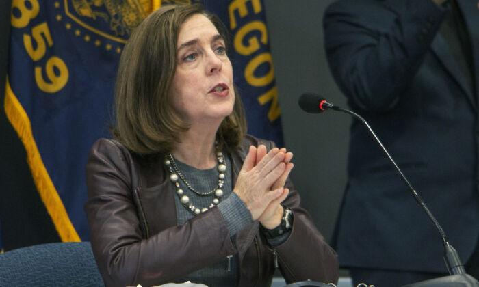 Oregon Gov. Kate Brown speaks in Portland, Oregon, on Nov. 10, 2020. (Cathy Cheney/Pool Photo via AP)