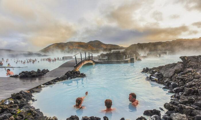 People bathe in the popular Blue Lagoon. (weniliou/Shutterstock)