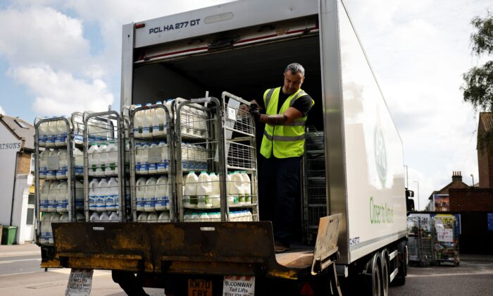 A truck driver makes a milk delivery to a supermarket in London on Aug. 3, 2021.  (Tolga Akmen / AFP via Getty Images)
