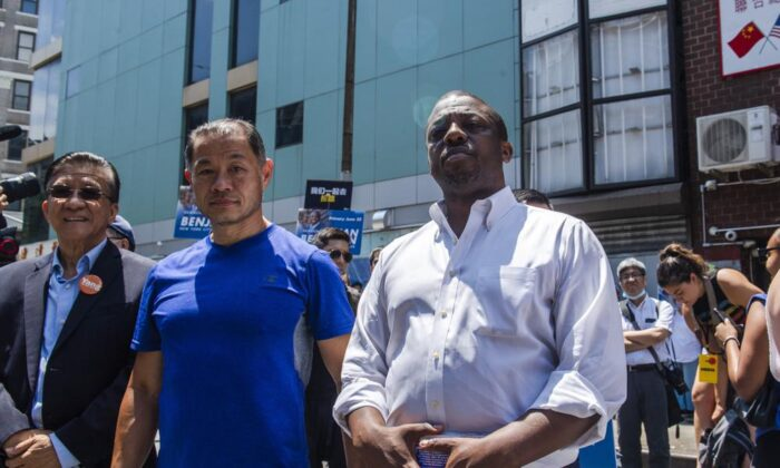 """New York State Senator Brian Benjamin, right, and State Senator John Liu, second from left, attend the """"Voting is Justice Rally,"""" in New York, on June 20, 2021. (Brittainy Newman/AP Photo)"""