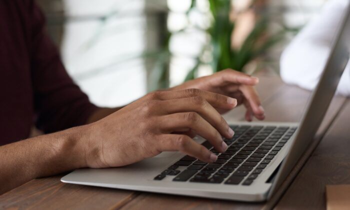 A person using laptop. (Fauxels/Pexels)