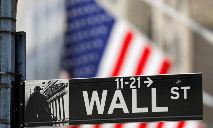 A street sign for Wall Street is seen outside the New York Stock Exchange (NYSE) in New York City, N.Y., on July 19, 2021. (Andrew Kelly/Reuters)