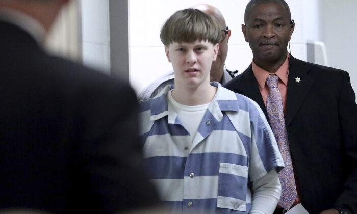 Dylann Roof enters the court room at the Charleston County Judicial Center to enter his guilty plea on murder charges in Charleston, S.C. on April 10, 2017. (Grace Beahm/The Post And Courier via AP)