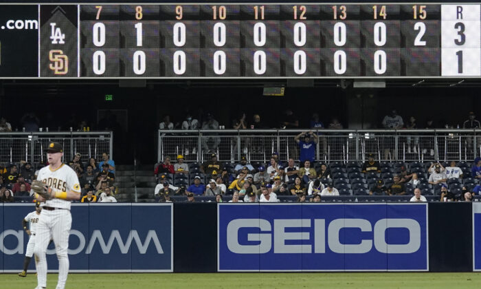 The San Diego Padres play the Los Angeles Dodgers during the fifteenth inning of a baseball game in San Diego, Calif. on Aug. 26, 2021. (AP Photo/Gregory Bull)