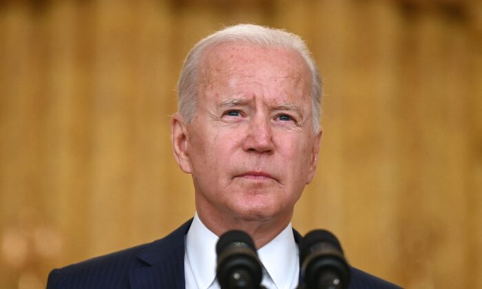 President Joe Biden delivers remarks on the terror attack at Hamid Karzai International Airport, and the U.S. service members and Afghan victims killed and wounded, in the East Room of the White House, Washington, on Aug. 26, 2021. (Jim Watson/AFP via Getty Images)
