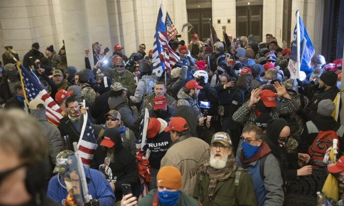 Protesters supporting U.S. President Donald Trump gather near the east front door of the U.S. Capitol after groups breached the building's security on Jan. 6, 2021. (Win McNamee/Getty Images)