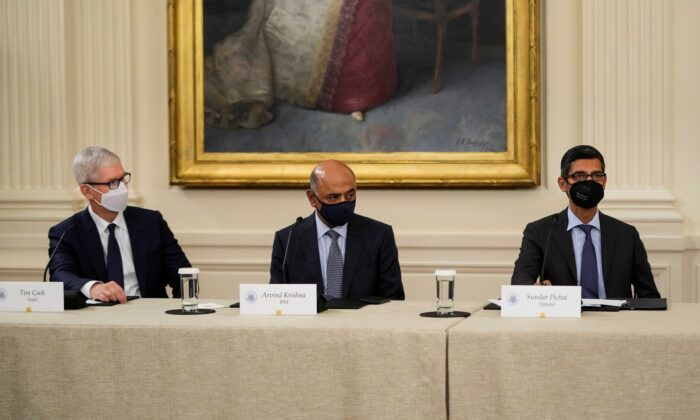 (L-R) Apple CEO Tim Cook, IBM CEO Arvind Krishna, and Google CEO Sundar Pichai listen as U.S. President Joe Biden speaks during a meeting about cybersecurity in the East Room of the White House on Aug. 25, 2021. (Drew Angerer/Getty Images)