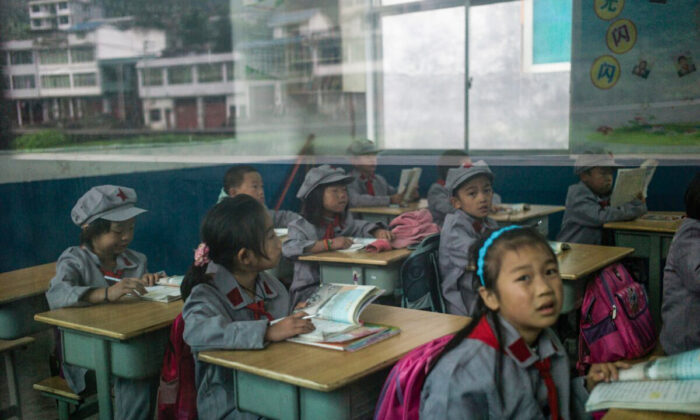 """Pupils sit in their classroom in the Yang Dezhi """"Red Army"""" Elementary School in Guizhou Province, China on Nov. 7, 2016. (Fred Dufour/AFP)"""