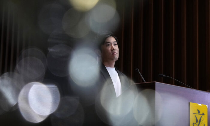 Lawmaker Cheng Chung-Tai pauses during a press conference after being disqualified from the legislature in Hong Kong, on Aug. 26, 2021. (Vincent Yu/AP Photo)