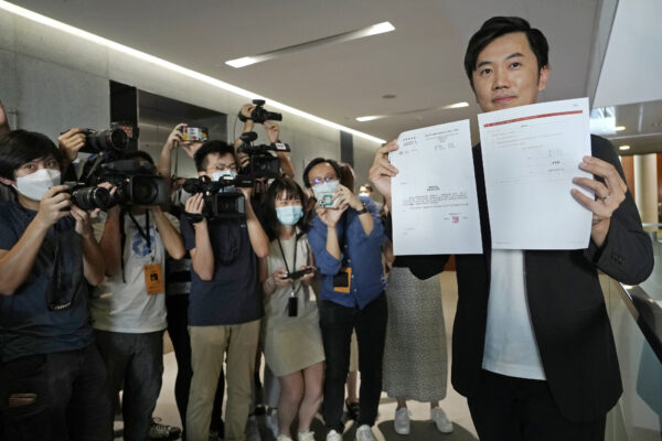 Lawmaker Cheng Chung-Tai displays document