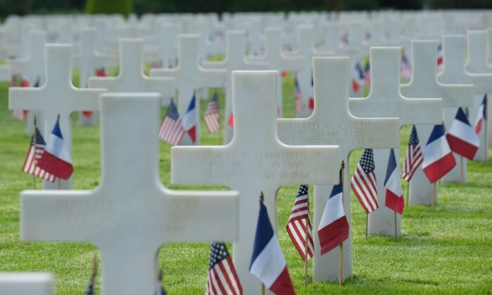 U.S. and French flags stand at the graves of U.S. soldiers at Normandy American Cemetery near Colleville-Sur-Mer, France on June 05, 2019. (Sean Gallup/Getty Images)