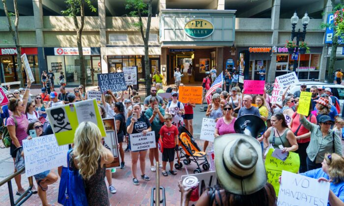 Protesters demonstrated near the Park Street subway station, and then marched to the Massachusetts Department of Public Health in Boston, Mass., on Aug 25, 2021. (Learner Liu/The Epoch Times)