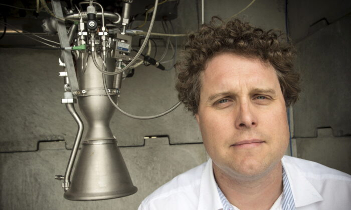 Rocket Lab CEO Peter Beck poses alongside a Rutherford rocket engine in Auckland, New Zealand, on Oct. 20, 2015. (Nigel Marple/Reuters)