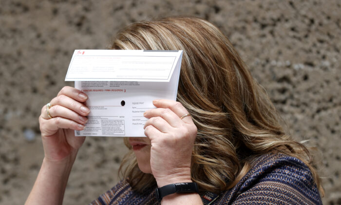 Santa Clara County Registrar of Voters' Shannon Bushey holds up a ballot envelope during a media presentation at the Santa Clara County registrar of voters office in San Jose, Calif., on Aug. 25, 2021. (Justin Sullivan/Getty Images)