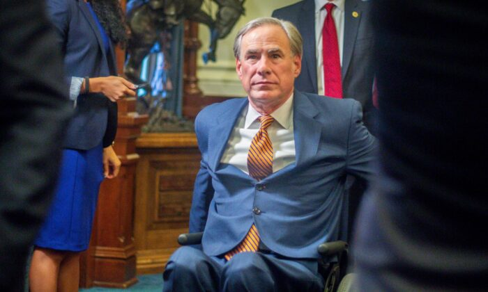 Texas Gov. Greg Abbott leaves a press conference where he signed Senate Bills 2 and 3 at the Capitol in Austin, Texas, on June 8, 2021. (Montinique Monroe/Getty Images)