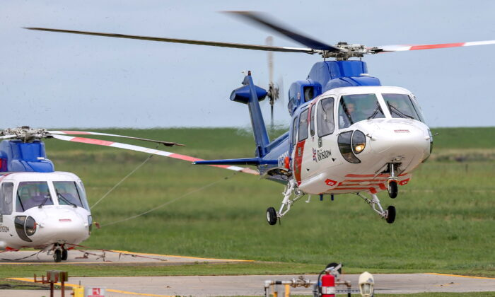 A helicopter carrying evacuated workers from oil production platforms lands ahead of Tropical Storm Cristobal, at Bristow Galliano Heliport in Galliano, La., on June 6, 2020. (Jonathan Bachman/Reuters)