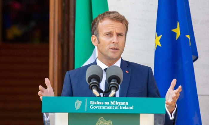 France's President Emmanuel Macron speaks during a joint press conference with Irish Prime Minister Micheal Martin (unseen) following their meeting at Government Buildings in Dublin on Aug. 26, 2021. (Paul Faith/AFP via Getty Images)