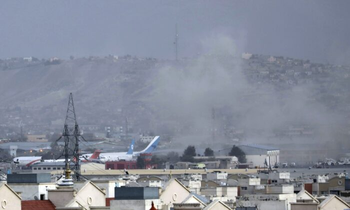 Smoke rises from a deadly explosion outside the airport in Kabul, Afghanistan, on Aug. 26, 2021. (Wali Sabawoon/AP Photo)
