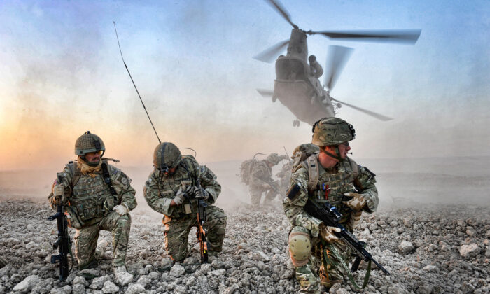 An air insertion operation mounted by British soldiers and Afghan police in Afghanistan, in an undated handout photo. (MoD/PA)