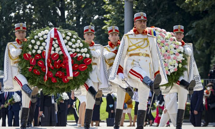 Honor guards carry wreaths during an event held to celebrate Moldova's national day, three decades after the country declared independence from the Soviet Union, in Chisinau, Moldova, on Aug. 27, 2021. (Aurel Obreja/AP Photo)