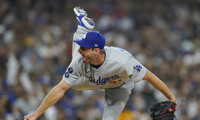 Los Angeles Dodgers starting pitcher Max Scherzer works against a San Diego Padres batter during the fourth inning of a baseball game in San Diego, Calif., on Aug. 26, 2021. (AP Photo/Gregory Bull)