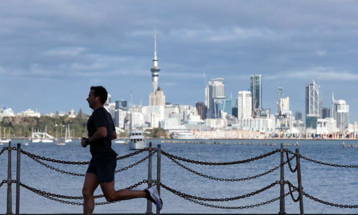 A runner exercises along Tamaki Drive on Auckland's waterfront in Auckland, New Zealand, on Aug. 24, 2021. (Fiona Goodall/Getty Images)
