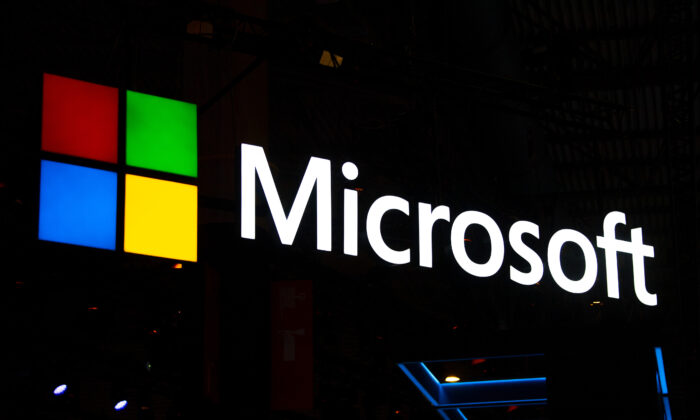 A logo sits illumintated outside the Microsoft booth on day 2 of the GSMA Mobile World Congress 2019 in Barcelona, Spain, on Feb. 26, 2019. (David Ramos/Getty Images)