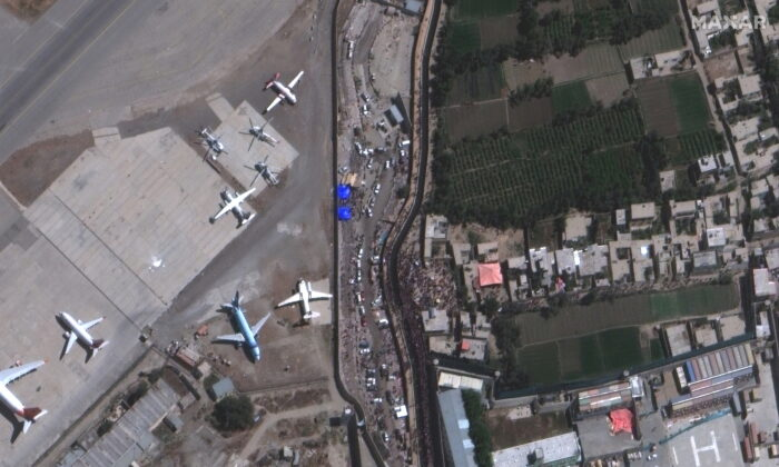 An overview of crowds at the Abbey Gate at Hamid Karzai International Airport, in Kabul, Afghanistan on Aug. 24, 2021, in this satellite image obtained by Reuters on Aug. 26, 2021. (Satellite image 2021 Maxar Technologies/Handout via Reuters)