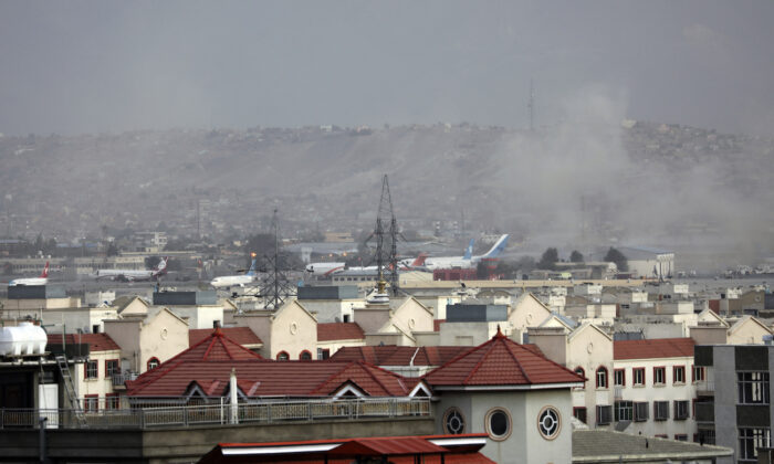 Smoke rises from an explosion outside the airport in Kabul, Afghanistan, on Aug. 26, 2021. (Wali Sabawoon/AP Photo)