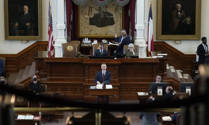 Texas Rep. Andrew Murr, a Republican (C) answers questions of fellow lawmakers as they debate voting bill SB1 in the House Chamber at the Texas Capitol in Austin, Texas, on Aug. 26, 2021. (Eric Gay/AP Photo)