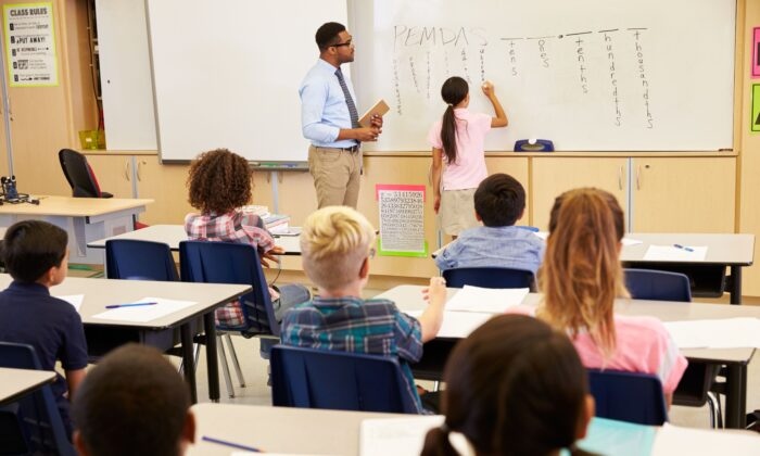 Students learn best when they are immersed in a content-rich learning environment that builds up their background knowledge. (Monkey Business Images/Shutterstock)