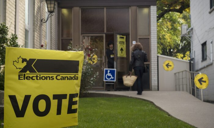 A woman enters a polling station at West Toronto Baptist Church in Toronto on Oct. 21, 2019. (The Canadian Press/Tijana Martin)